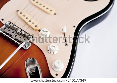 Close up of electric guitar isolated on white background - stock photo