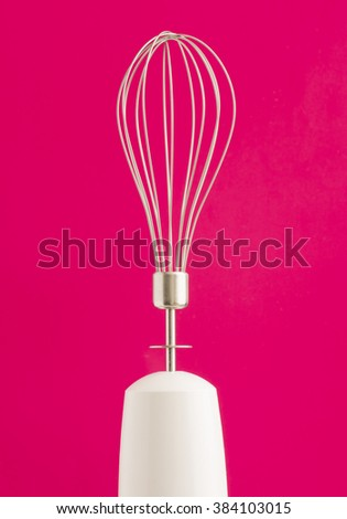 Close up of electric mixer. Kitchenware object for baking or mixing food. - stock photo