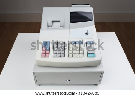 Close-up Of Electronic Cash Register Moneybox On Counter - stock photo