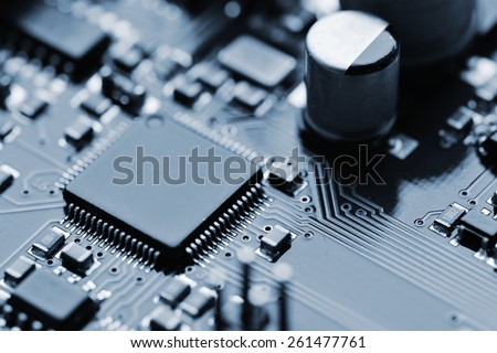 Close-up of electronic circuit board with components - stock photo