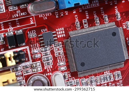 Close-up of electronic circuit red board with processor - stock photo