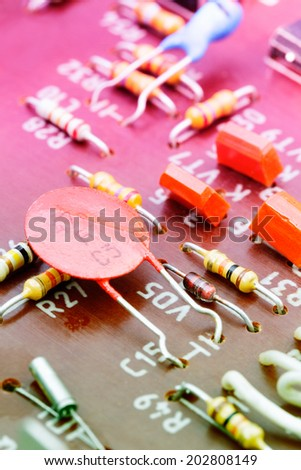 Close up of electronic components on a obsolete printed-circuit board  - stock photo