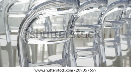 Close up of elegant contemporary designed plastic chairs, shot from the back - stock photo