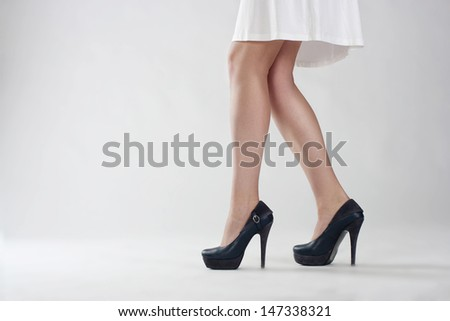 Close up of elegant female legs walking  - stock photo