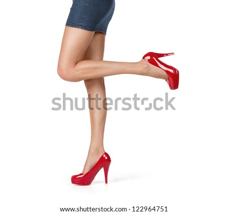 Close up of elegant female legs walking isolated on white background - stock photo
