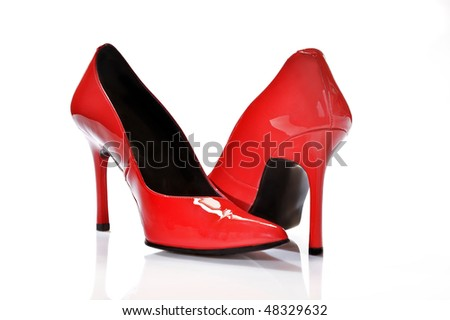 Close-up of elegant female red shoes on a white background