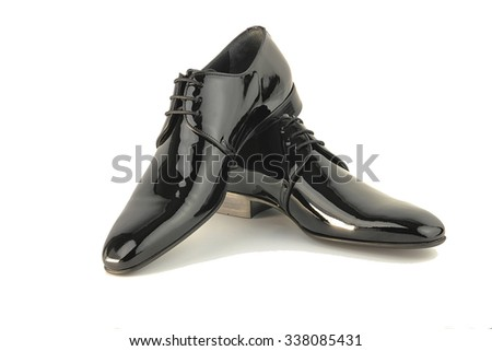 Close-up of elegant mens shoes on white background - stock photo