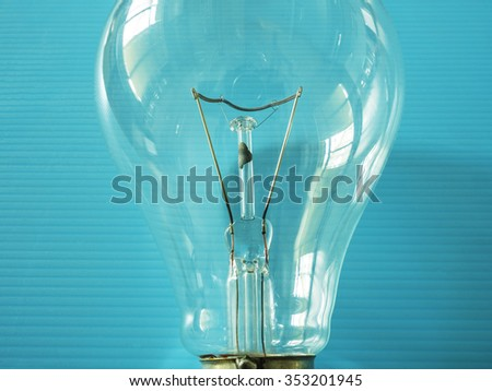 close up of element in the incandescent light bulb, showing wire which electric current flowing in the tungsten filament - stock photo