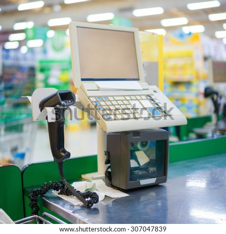 Close up of empty cash desk with computer terminal in store