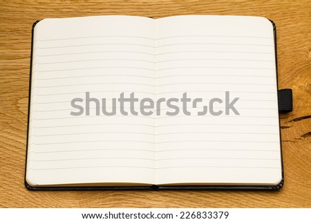 Close up of empty pages of a notebook on a desk. Make the notes for your business. Space for copy in textbook. - stock photo