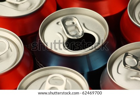 Close up of empty soft drink or soda cans used and ready for waste disposal and recycling - stock photo