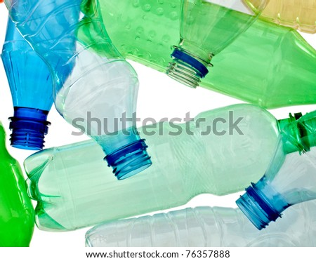 close up of empty used plastic bottles on white background with clipping path - stock photo