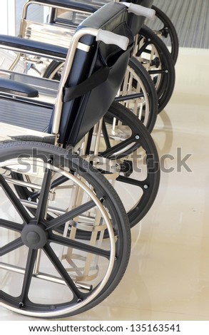 Close up of empty wheelchair in hospital - stock photo