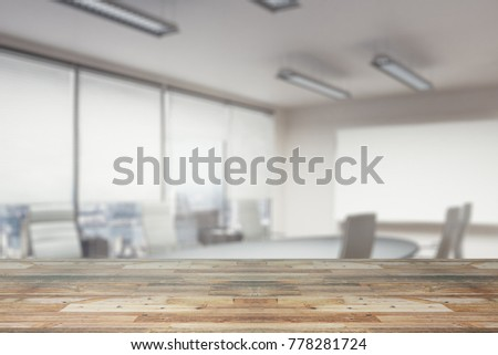 Close Up Of Empty Wooden Table Surface Or Counter With Blurry Office Wallpaper Copy