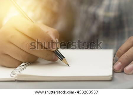 Close up of engineer hand sketching a construction project with Pencil.