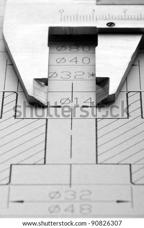 Close-up of engineering drawing and caliper - stock photo
