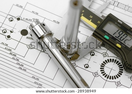Close up of engineering drawing with callipers