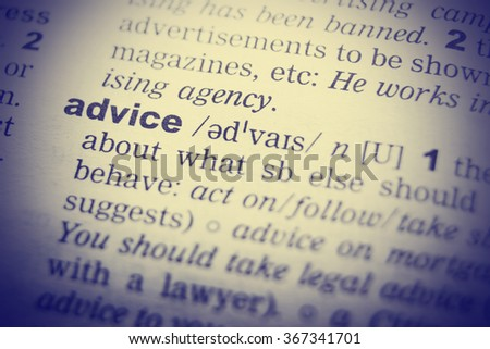 Close up of English dictionary page with word advice - stock photo