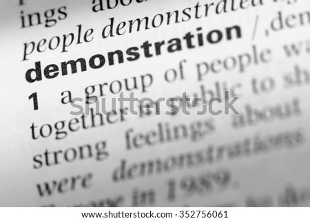 Close up of English dictionary page with word demonstration - stock photo