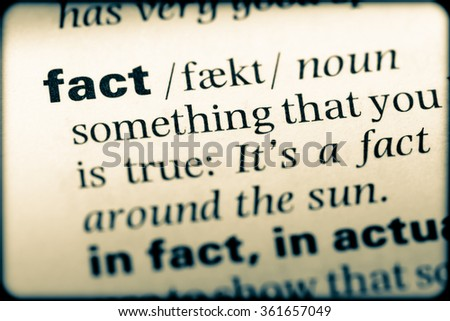 Close up of English dictionary page with word fact - stock photo