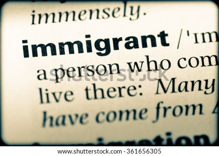 Close up of English dictionary page with word immigrant - stock photo