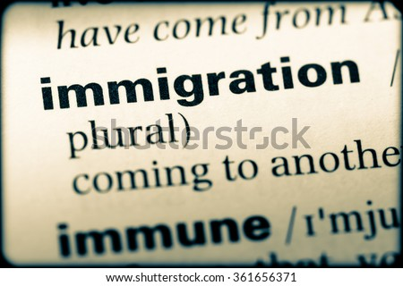 Close up of English dictionary page with word immigration - stock photo