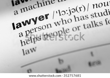Close up of English dictionary page with word lawyer - stock photo