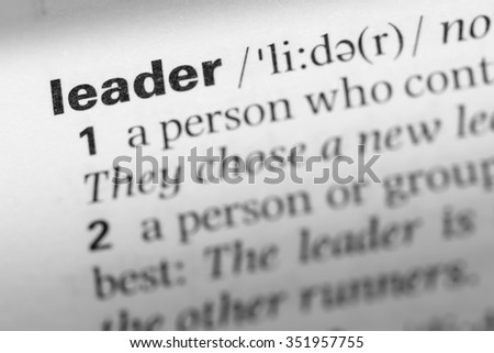 Close up of English dictionary page with word leader - stock photo