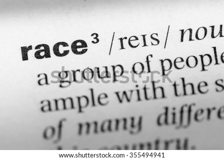 Close up of English dictionary page with word race - stock photo