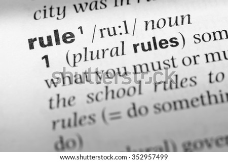 Close up of English dictionary page with word rule - stock photo