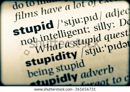 Close up of English dictionary page with word stupid - stock photo
