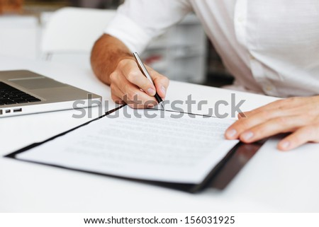 Close up of entrepreneur signing contract