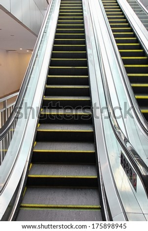 Close-up of escalator at public entrance. - stock photo