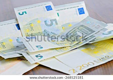 Close-up of Euro banknotes on the table - stock photo