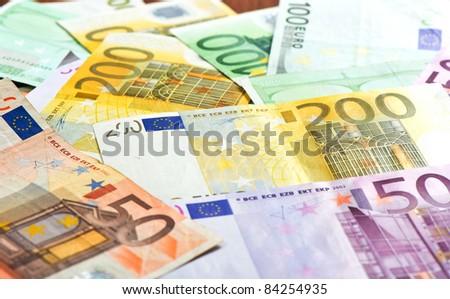 Close-up of Euro banknotes. selective focus - stock photo