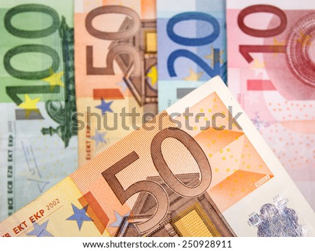 Close up of Euro banknotes with 50 Euros in focus - stock photo