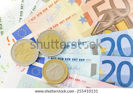 Close-up of euro coins and banknotes - stock photo