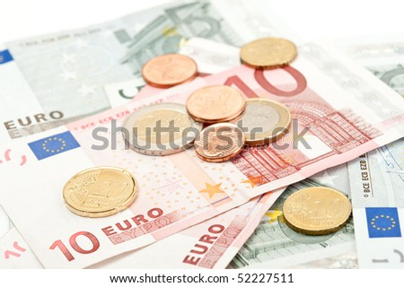 Close-up of euro coins and banknotes
