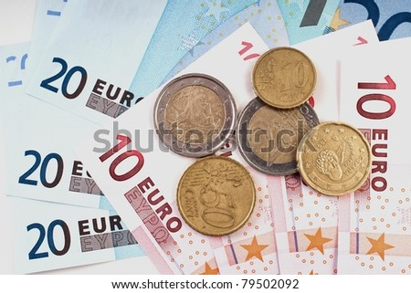 Close up of european Euro coins and bank notes - stock photo