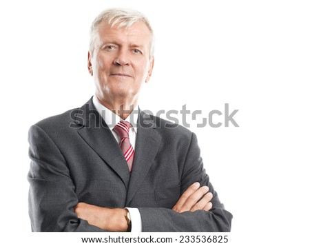 Close-up of executive senior businessman standing against white background. - stock photo