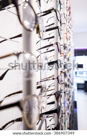 Close-up of exhibition with modern eyeglasses at optician's