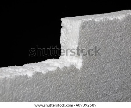 Close up of expanded polystyrene on black background