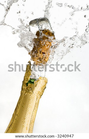 Close-up of explosion of champagne bottle cork - stock photo