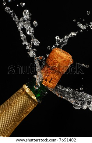 Close-up of explosion of Christmas champagne bottle cork