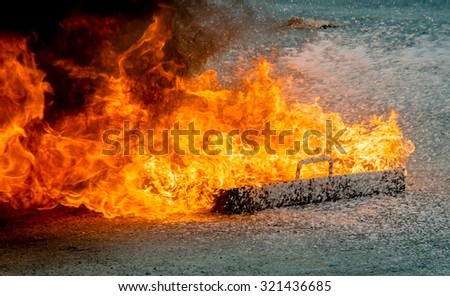 Close up of extinguishes a fire, fire extinguisher on a training fire