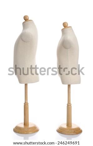 Close up of fabric dummies on white background isolated - stock photo