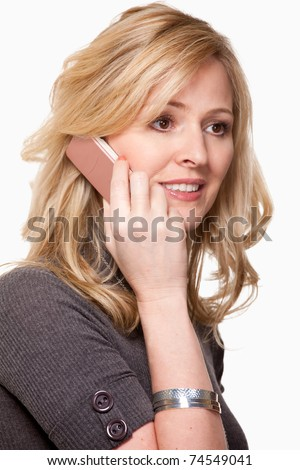 Close up of face of an attractive blond woman holding a pink cell phone over white smiling