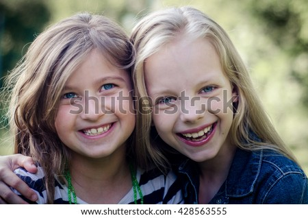 Close up of face of happy children while laughing. - stock photo