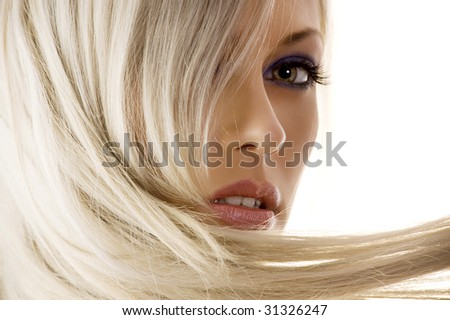 close_up of face of pretty girl with long blond hair watching in camera - stock photo
