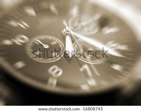 close-up of face of wrist watch sepia toned - stock photo